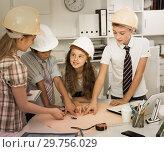Купить «Teens engineers discussing draft at the table», фото № 29756029, снято 12 октября 2017 г. (c) Яков Филимонов / Фотобанк Лори