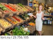 Купить «Woman shopping veggies», фото № 29756105, снято 27 мая 2019 г. (c) Яков Филимонов / Фотобанк Лори