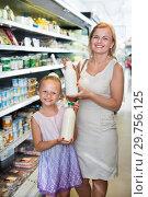 Купить «Woman and girl picking fresh dairy products in refrigerated section», фото № 29756125, снято 23 января 2019 г. (c) Яков Филимонов / Фотобанк Лори