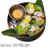 Купить «Delicious ceviche rolls with white fish and rice paper in vietnamese style», фото № 29756281, снято 27 марта 2019 г. (c) Яков Филимонов / Фотобанк Лори
