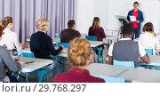 Купить «Students with teacher studying in classroom», фото № 29768297, снято 8 мая 2018 г. (c) Яков Филимонов / Фотобанк Лори