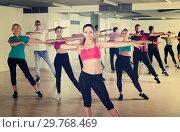 Купить «Smiling people dancing together in dance studio», фото № 29768469, снято 9 октября 2017 г. (c) Яков Филимонов / Фотобанк Лори