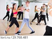 Купить «couples enjoying of partner dance», фото № 29768481, снято 9 октября 2017 г. (c) Яков Филимонов / Фотобанк Лори