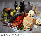 Купить «Still life with tasty seafood, wine, cheese and bread», фото № 29768813, снято 10 февраля 2018 г. (c) Яков Филимонов / Фотобанк Лори