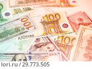 Купить «Dollars and euro bills background. Close up cash money.», фото № 29773505, снято 20 января 2019 г. (c) bashta / Фотобанк Лори