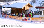 Купить «Chairlift in mountain ski resort in winter sunny day», видеоролик № 29773661, снято 23 января 2019 г. (c) FotograFF / Фотобанк Лори