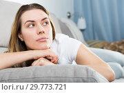 Купить «Young female is thoughtful and bored alone», фото № 29773721, снято 29 марта 2018 г. (c) Яков Филимонов / Фотобанк Лори