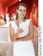 Купить «Woman observing museum exposition», фото № 29773777, снято 28 июля 2018 г. (c) Яков Филимонов / Фотобанк Лори