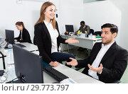 Купить «Young businesswoman flirting with Hispanic male colleague during work in modern coworking space», фото № 29773797, снято 24 марта 2018 г. (c) Яков Филимонов / Фотобанк Лори