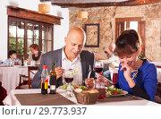 Купить «Happy couple spending time in restaurant», фото № 29773937, снято 12 декабря 2018 г. (c) Яков Филимонов / Фотобанк Лори