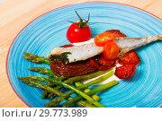 Купить «Blue whiting fish baked with dried tomatoes», фото № 29773989, снято 23 августа 2018 г. (c) Яков Филимонов / Фотобанк Лори