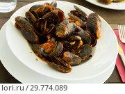 Купить «Mussels with tomato sauce», фото № 29774089, снято 28 мая 2020 г. (c) Яков Филимонов / Фотобанк Лори