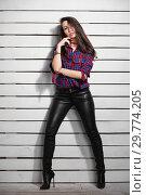 Купить «Beautiful young brunette posing in the studio.», фото № 29774205, снято 26 апреля 2016 г. (c) Сергей Сухоруков / Фотобанк Лори