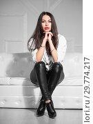Купить «Pretty woman posing sitting.», фото № 29774217, снято 26 апреля 2016 г. (c) Сергей Сухоруков / Фотобанк Лори