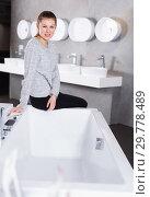 Young woman customer in bathroom fitment store. Стоковое фото, фотограф Яков Филимонов / Фотобанк Лори