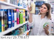 Купить «Nice girl choosing hair care treatments», фото № 29778677, снято 31 января 2018 г. (c) Яков Филимонов / Фотобанк Лори