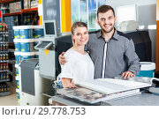 Купить «Young couple choosing wallpaper from samples at magazine in household shop», фото № 29778753, снято 17 мая 2018 г. (c) Яков Филимонов / Фотобанк Лори