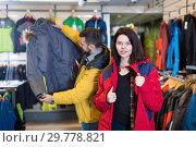 Купить «Young woman deciding on windcheater in store», фото № 29778821, снято 8 марта 2017 г. (c) Яков Филимонов / Фотобанк Лори