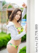 Купить «Alluring woman dressed in swimsuit.», фото № 29778889, снято 1 июня 2016 г. (c) Сергей Сухоруков / Фотобанк Лори