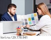 Купить «Competent seller in showroom helping young female client to choose furniture materials for her apartment», фото № 29778941, снято 9 апреля 2018 г. (c) Яков Филимонов / Фотобанк Лори