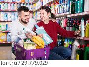 Купить «two friendly adult people in good spirits selecting detergents in the store», фото № 29779029, снято 14 марта 2017 г. (c) Яков Филимонов / Фотобанк Лори