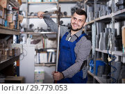 Positive male worker showing various tools. Стоковое фото, фотограф Яков Филимонов / Фотобанк Лори