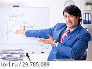 Купить «Busy businessman explaining business charts», фото № 29785089, снято 15 октября 2018 г. (c) Elnur / Фотобанк Лори