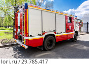 Купить «Red fire truck EMERCOM of Russia and rescue vehicle», фото № 29785417, снято 9 мая 2018 г. (c) FotograFF / Фотобанк Лори