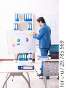 Купить «Male sales analyst in front of the whiteboard», фото № 29785569, снято 20 октября 2018 г. (c) Elnur / Фотобанк Лори