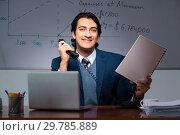 Купить «Financial specialist working late in the office», фото № 29785889, снято 25 октября 2018 г. (c) Elnur / Фотобанк Лори