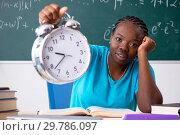 Купить «Black female student in front of chalkboard», фото № 29786097, снято 26 октября 2018 г. (c) Elnur / Фотобанк Лори
