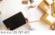 Купить «woman with laptop and clipboard at post office», видеоролик № 29787421, снято 19 января 2019 г. (c) Syda Productions / Фотобанк Лори