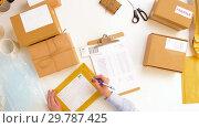 Купить «woman with laptop and clipboard at post office», видеоролик № 29787425, снято 19 января 2019 г. (c) Syda Productions / Фотобанк Лори