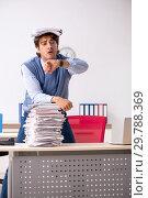 Купить «Young handsome employee unhappy with excessive work», фото № 29788369, снято 5 октября 2018 г. (c) Elnur / Фотобанк Лори