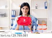 Купить «Female doctor with first aid bag», фото № 29789081, снято 15 ноября 2018 г. (c) Elnur / Фотобанк Лори