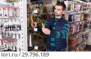 Fisherman consumer buying new fishing lures. Стоковое фото, фотограф Яков Филимонов / Фотобанк Лори