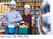 Купить «Adult woman with man in helmet with instruments», фото № 29796233, снято 16 февраля 2018 г. (c) Яков Филимонов / Фотобанк Лори