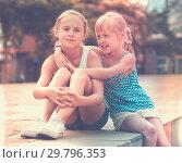 Купить «Two smiling little girls embracing», фото № 29796353, снято 20 июля 2017 г. (c) Яков Филимонов / Фотобанк Лори