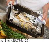 Купить «Baked with lemon dorado fish», фото № 29796425, снято 22 ноября 2018 г. (c) Яков Филимонов / Фотобанк Лори