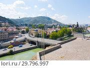 Купить «Embankment of the Mtkvari river and historic Sololaki district in Tbilisi. Summer day», фото № 29796997, снято 7 августа 2013 г. (c) Олег Хархан / Фотобанк Лори