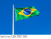 Flag of Brazil waving in the wind against the sky. Стоковое фото, фотограф FotograFF / Фотобанк Лори