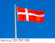 Купить «Flag of Denmark waving in the wind against the sky», фото № 29797185, снято 17 июня 2018 г. (c) FotograFF / Фотобанк Лори