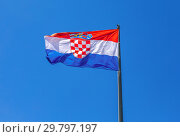 Купить «Flag of Croatia waving in the wind against the sky», фото № 29797197, снято 17 июня 2018 г. (c) FotograFF / Фотобанк Лори