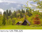 Купить «mountain and house in alps at spring», фото № 29798225, снято 2 мая 2017 г. (c) Михаил Коханчиков / Фотобанк Лори