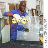 Купить «Cheerful glazier during daily work», фото № 29798781, снято 16 мая 2018 г. (c) Яков Филимонов / Фотобанк Лори