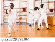 Купить «African american man fencer in training room», фото № 29798861, снято 11 июля 2018 г. (c) Яков Филимонов / Фотобанк Лори