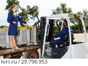 Купить «Engineers checking delivered grapes harvest», фото № 29798953, снято 12 сентября 2018 г. (c) Яков Филимонов / Фотобанк Лори