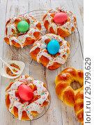 Купить «Easter Bread wreaths glazed around dyed eggs», фото № 29799629, снято 20 января 2019 г. (c) Oksana Zh / Фотобанк Лори