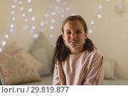 Купить «Innocent girl sitting in bedroom at home», фото № 29819877, снято 6 ноября 2018 г. (c) Wavebreak Media / Фотобанк Лори