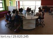 Купить «Group of schoolkids studying on desktop pc in school», фото № 29820245, снято 10 ноября 2018 г. (c) Wavebreak Media / Фотобанк Лори